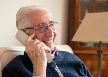Smiling man on a phone
